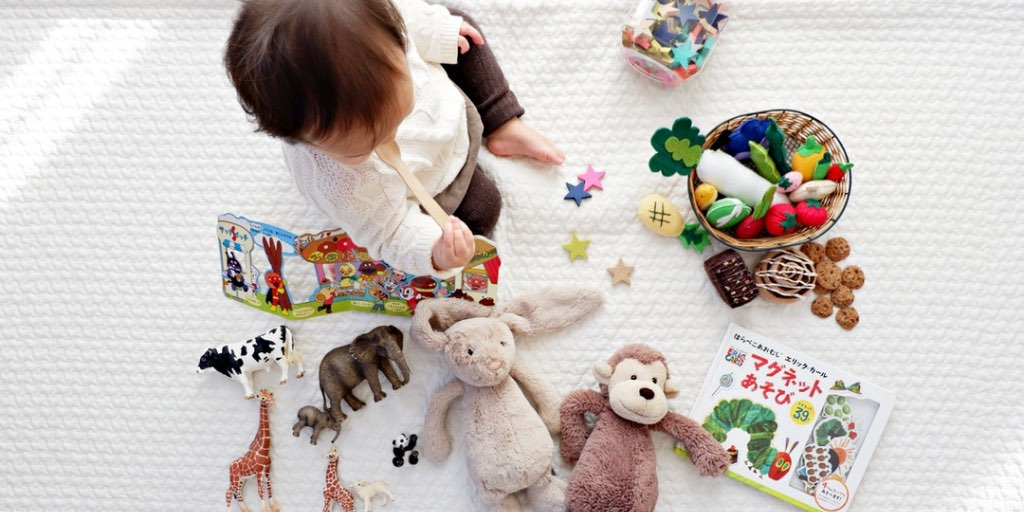 Baby playing with gifts and toys